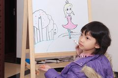 Asian kid drawing Royalty Free Stock Photography