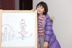 Asian kid drawing Royalty Free Stock Image