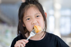 Asian Kid Enjoy Eating Food, Fried Spring Roll. Cute Asian kid enjoy eating food, fried spring roll stock photo