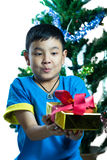 Asian kid get Christmas present Royalty Free Stock Photos