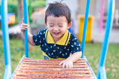 Asian kid goes up the stairs in the park. concept of growing up. Step by step the child rises higher and goes further Stock Photos
