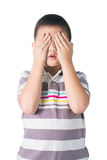 Asian Kid hide face under hands, playing hide-and-seek, isolated Stock Photography