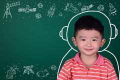 Asian kid with his imagination about science and space adventure. Hand drawn on the green chalkboard, education back to school and discovery concept idea royalty free stock photos