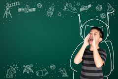 Asian kid with his imagination about science and space adventure. Hand drawn on the green chalkboard, education back to school and discovery concept idea stock images