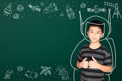 Asian kid with his imagination about science and space adventure. Hand drawn on the green chalkboard, education back to school and discovery concept idea royalty free stock photo