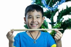 Asian kid hold drum stick Royalty Free Stock Image