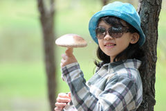 Asian kid holding mushroom Stock Photography