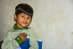 An Asian kid holding school book Stock Photo