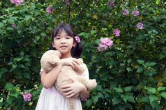 Asian kid holding a toy dog Royalty Free Stock Photography