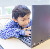 Asian kid with laptop Stock Photo