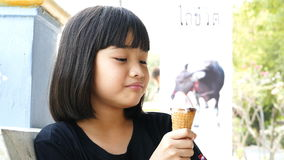 Asian kid licking ice cream. stock video footage
