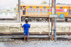 Asian kid looking for train. At reailway station Stock Images