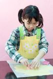 Asian kid making cookies Stock Photo