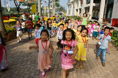 Asian kid, outdoor activity, Vietnamese preschool children. HO CHI MINH CITY, VIET NAM- FEB12: Group of unidentified Asian kid with outdoor activity of preschool Royalty Free Stock Photography