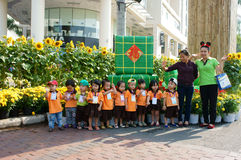 Asian kid, outdoor activity, Vietnamese preschool children. HO CHI MINH CITY, VIET NAM- FEB12: Group of unidentified Asian kid with outdoor activity of preschool Royalty Free Stock Photos