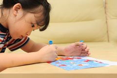 Asian kid painting Stock Photo