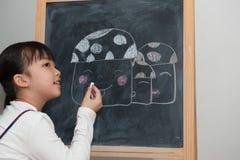 Asian kid painting Royalty Free Stock Photos