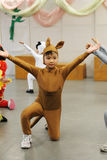 Asian kid performing. A little Chinese kid acting as a kangaroo on the stage Royalty Free Stock Photos