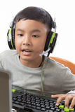Asian kid play computer games and talking with friend Stock Photo