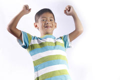 Asian kid playing. On a studio with white background stock photos