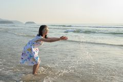 Asian kid playing on beach Royalty Free Stock Photography