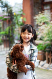 Asian kid playing with dog Stock Photos