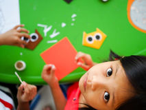 Asian Kid Playing with  Origami Paper Royalty Free Stock Photos
