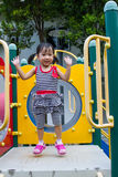 Asian Kid playing on Playground Stock Photography