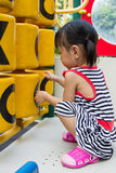 Asian Kid playing on Playground Royalty Free Stock Photos