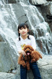 Asian kid playing with poodle dog Royalty Free Stock Images