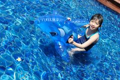 Asian kid playing in swimming pool Stock Images