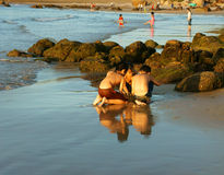 Asian kid playing together on beach Royalty Free Stock Photos