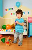 Asian kid playing with toys Royalty Free Stock Photo
