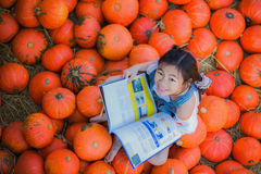 Asian kid reading a book. In farm with top view photo Royalty Free Stock Image