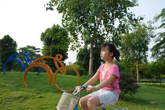Asian kid riding bike Royalty Free Stock Photo