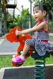 Asian Kid Riding at Park Royalty Free Stock Photo