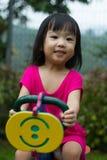 Asian Kid Riding at Park Royalty Free Stock Images