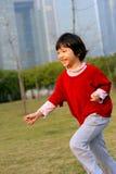 Asian kid run. An Asian kid running on the lawn Royalty Free Stock Image