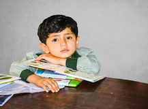 An Asian kid with school books Stock Photography