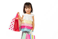 Asian Kid with shopping bag Royalty Free Stock Photos