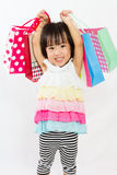 Asian Kid with shopping bag Royalty Free Stock Images
