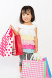 Asian Kid with shopping bag Stock Images