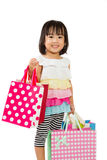 Asian Kid with shopping bag Royalty Free Stock Photography