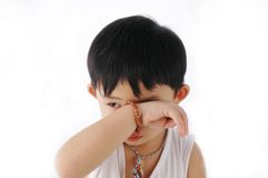 Asian kid sleepy. Cute little asian kid with sleepy feel Stock Image