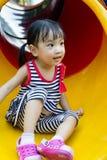 Asian kid sliding on Playground Royalty Free Stock Photography