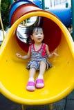 Asian kid sliding on Playground Royalty Free Stock Images