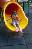 Asian kid sliding on Playground Stock Photo