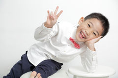 Asian kid smile and post very cute. With white background Royalty Free Stock Images