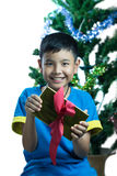 Asian kid smile receive Christmas gift Stock Image