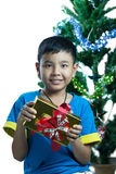 Asian kid smile receive Christmas gift. On white background Stock Photography